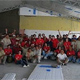 Regnum Christi members with prisoners, building a chapel together.