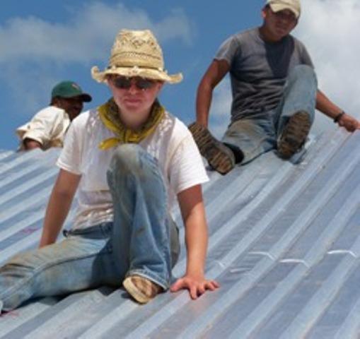 Barbara repairing a roof