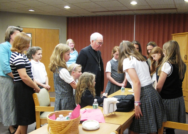 Challenge girls present club to bishop