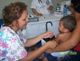 Christina Wilson, from Kileen, TX, cares for a small child on the mission to Brazil.