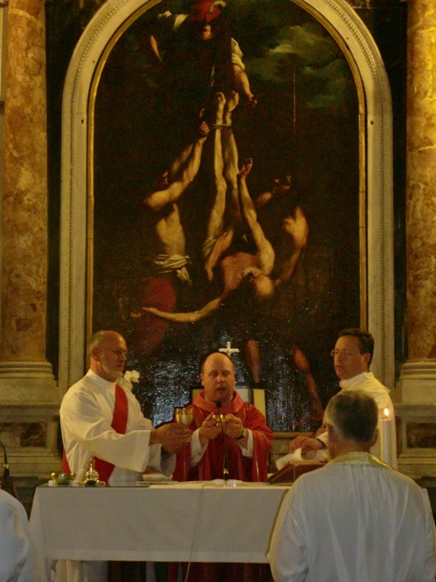 priest celebrating Mass in Rome