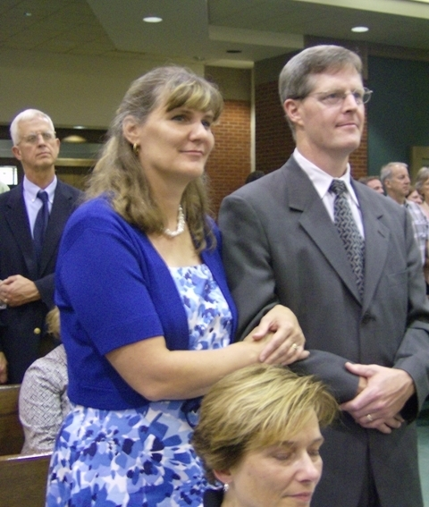 Couple stands during renewal of vows