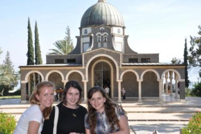Kayce Crone, Elyse Herbert, and Lucia Benavides in front of the Church of the Beatitudes