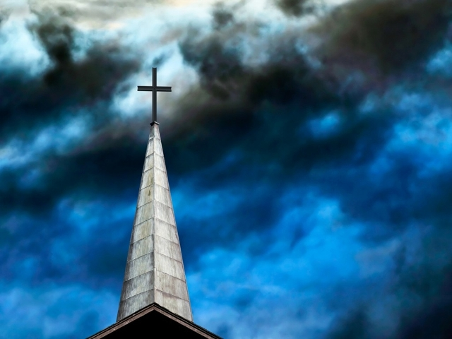 cross and stormy sky