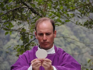 Evaristo Sada, LC, with Eucharist