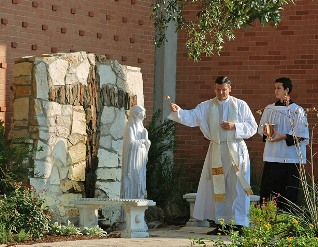 Fr Alphonse blesses the grotto