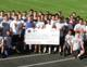 The Kennedy High Trojans raised $10,000 for a family in need.
