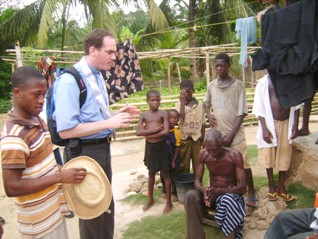 Fr Jeffery Jambon, LC, with kids in Ghana
