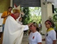 During the commissioning Mass, Bishop Pedro Pablo Elizondo lays hands on a young missionary's head.