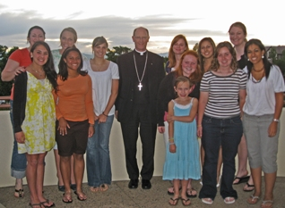 Auxiliary Bishop James D. Conley, S.T.L, of the Archdiocese of Denver, with local Challenge girls.