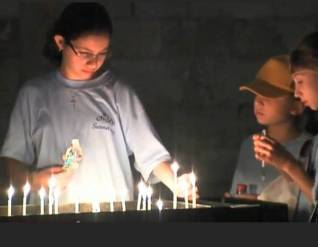 girls light candles at dormition