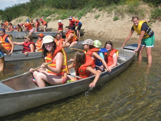 campers in canoes