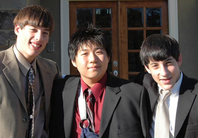 Jin Kim (center) with two friends from Pinecrest Academy.