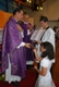 Newly consecrated member Joana Ferraz receives a Bible from Fr Aromir. The acolyte is her Legionary brother.