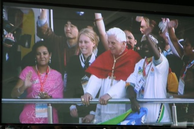 Katie and Pope Benedict as boat rides into harbour