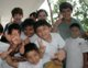 Missionaries and local kids give the thumbs up and &quot;V&quot; for victory sign.