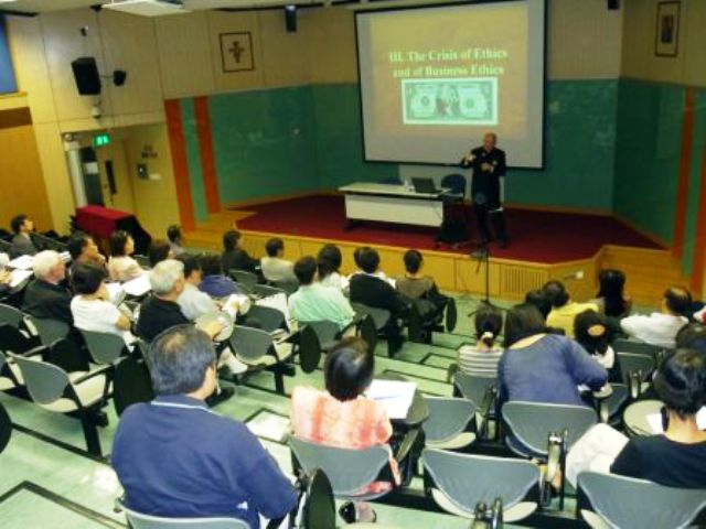 Fr Michael Ryan giving talk in China