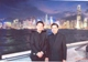 Fr Joseph Tham and Fr Mattias Kim stand before the Hong Kong skyline.