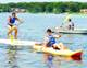 OUTDOORS�Young men take to the lake in canoes and kayaks at Camp Veritas. Photo: Maria R. Bastone