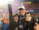 Terry Malone and two of his daughters relish the taste of victory.