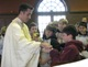 Fr Richard Sutter, LC, chaplain at Christian Brothers School in City Park, distributes Communion to students.