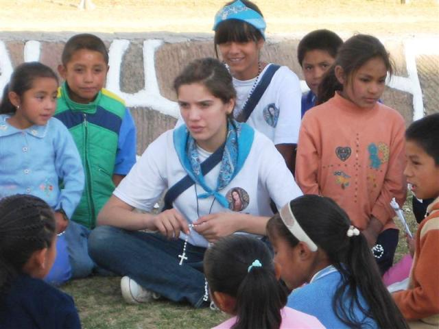 Woodlands girl teaching rosary