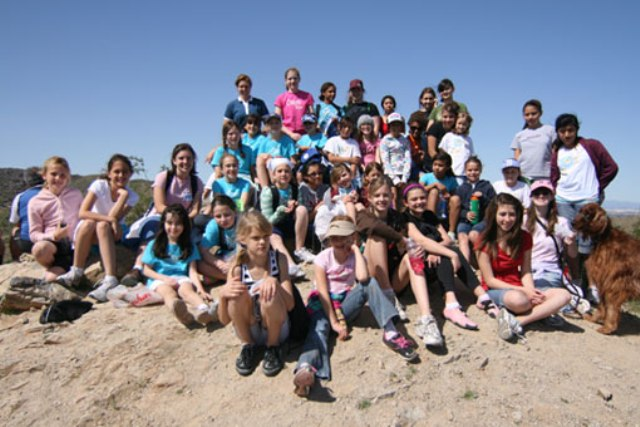 Challenge girls hike mountain