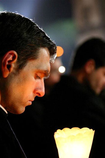 Fr. Timothy prays in St. Peter�s square during the last days of illness of Pope John Paul II