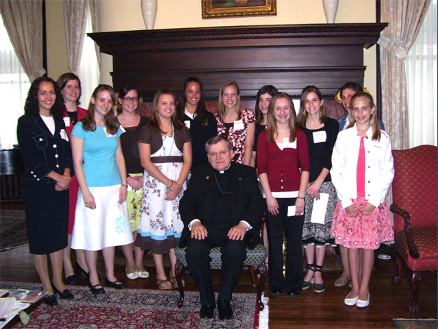 Annie Hofstetter (first one on the right) and her Challenge Team with Archbishop Raymond Burke of St. Louis.