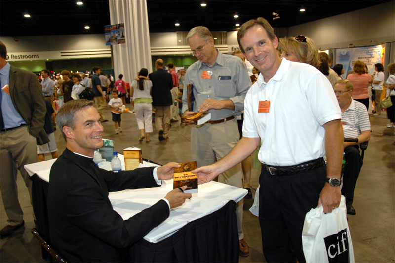 Father John Bartunek signing books at the International YFE in Atlanta.