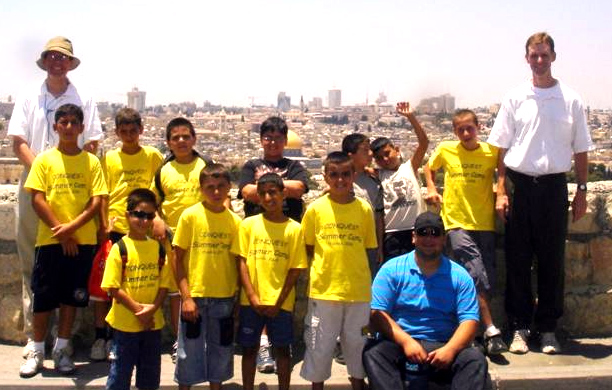 The Palestinian Conquest boys overlooking the Old City of Jerusalem with Fr Eamon Kelly (left) and Deacon Michael Sullivan (right).