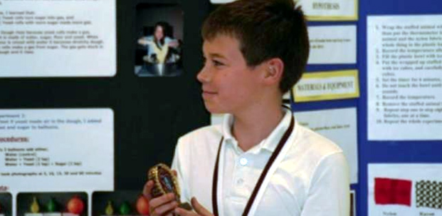 A Canyon Heights student stands ready to explain his science fair project.