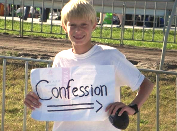 An ECYD boy promotes the sacrament of Confession.
