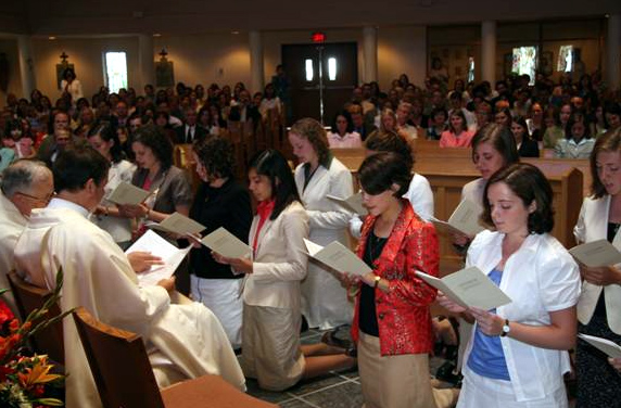 The 13 young women make their consecration promises for the first time.