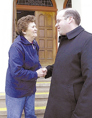 The Rev. Nikola Derpich is greeted after Mass on Tuesday by Slavica Zalac, parishioner at Our Lady Help of Christians Church in Watsonville