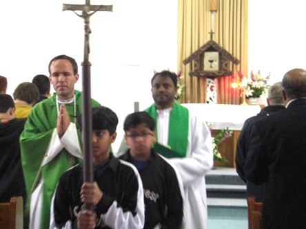 A moment from the Mass that the Conquest boys shared.