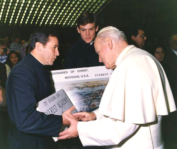 Fr Lorenzo Gomez LC and Br Joseph Burtka LC present the first plans to Pope John Paul II in 1991.