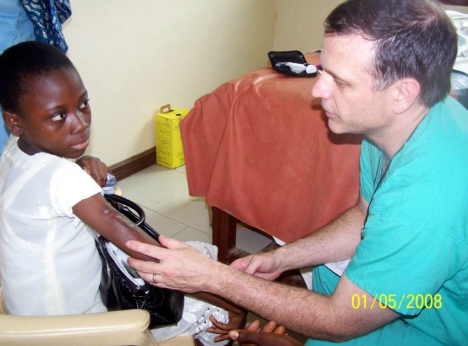 Dr Harrison giving a pediatric consultation at the hospital in Bibiani.