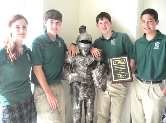 The Pinecrest Paladin Academic Team. L-R: Sophomore Kate Foster and juniors Michael Williams, Rob Herd, and Roberto Ocon with their 1st Place plaque.