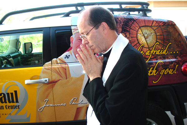 Bishop Thomas Olmsted blessing the Pope Mobile.