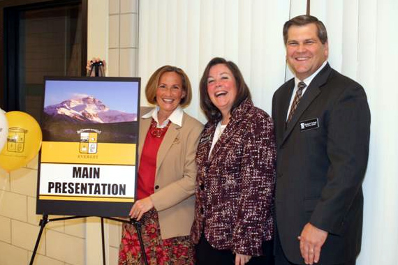 Dr. Coleen Mast poses near a sign touting her appearance at the school open house for Everest on Nov. 9, 2008.  Standing with her (from left to right) are Maura Plante, Everest Director of Admissions, and Michael Nalepa, Everest Executive Director.