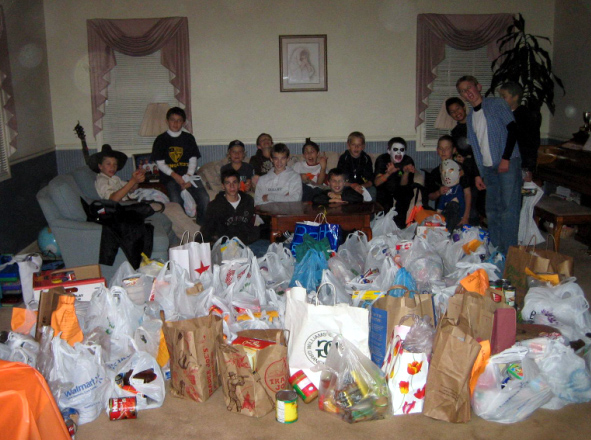 All in a night's work... The boys gathered over 1,100 pounds of food for the poor.