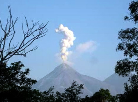One of the active volcanoes flanking the town.