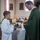 Matthias receives his missionary cross from Father Cliff Ermatinger, LC.