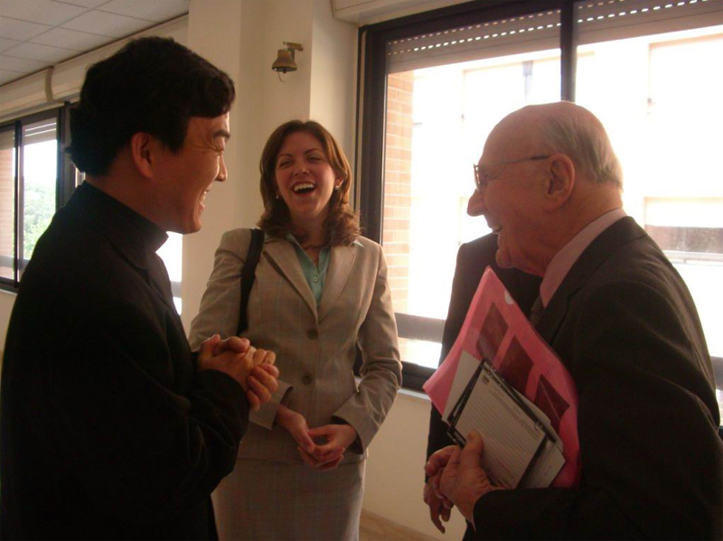 2.	Dr Pellegrino enjoys a moment of laughter with some students in the program.