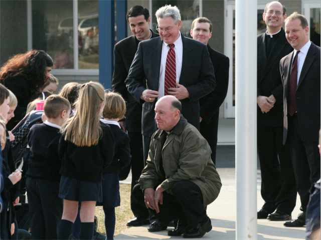 Bishop Malooly greets students accompanied by Brother Ugo Piasentin, L.C., Brother John Pietrapaoli, L.C., Father Steven Reilly, L.C., and Executive Director of Woodmont Academy, Scott Brown.