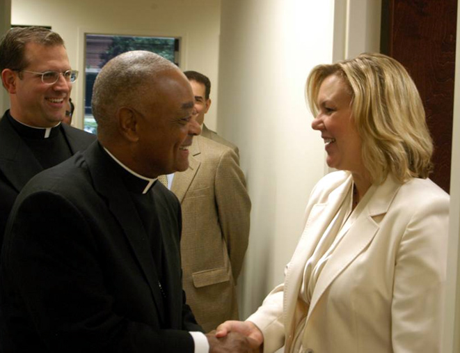 Archbishop Gregory greets Melissa Foley, the national director of Mission Network girls� programs.