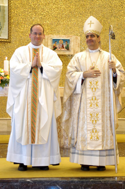 Archbishop Eterovic and the new priest