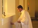 Fr Eamonn Shelly, LC anoints the walls of the chapel.