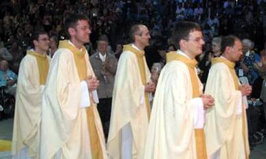 The newly ordained priests processing into Mass the day after their ordination.